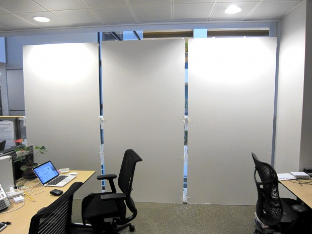 Blank research wall in an office, next to desks and chairs