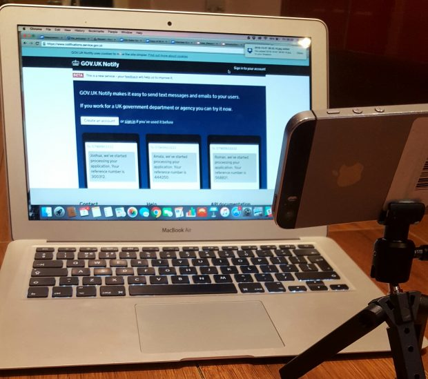 Setup for streaming remote research with laptop and mobile on a stand