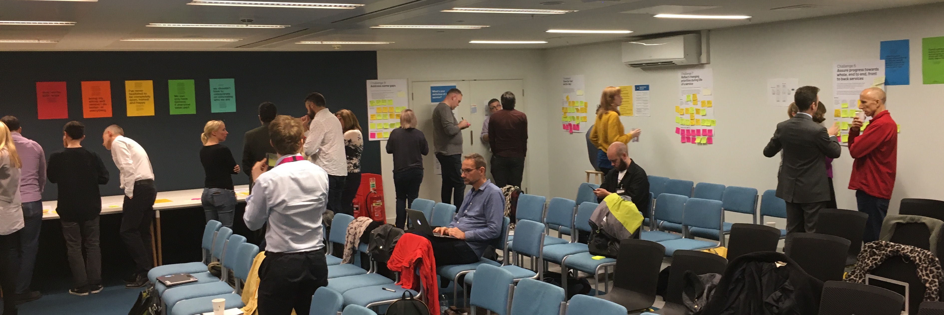 Photo of people from across government taking part in a workshop on the updated Service Standard