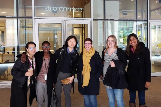 The author, Stephanie Marsh, standing outside the Canadian Digital Service building with of its five employees.