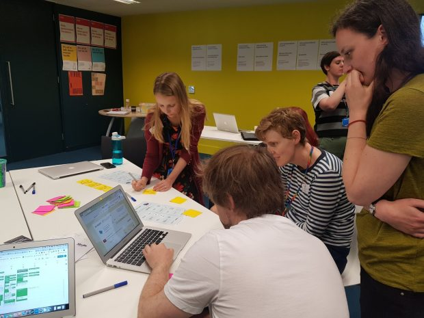 Photo of aphasia advisor Ben and GDS User researcher doing a usability task together