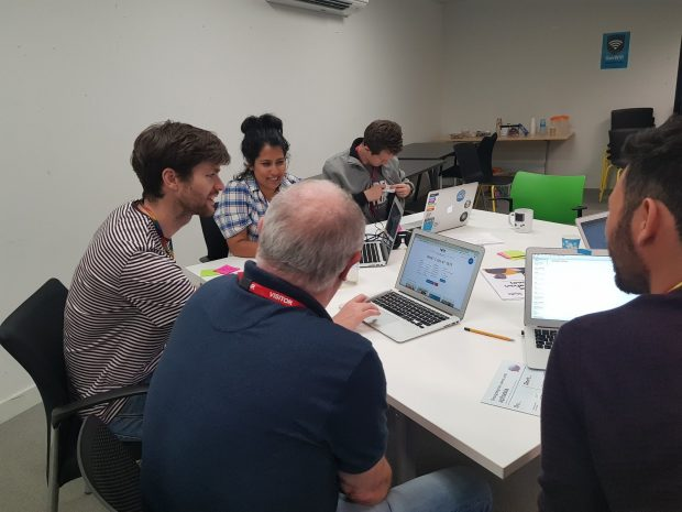 Photo of aphasia advisor Ian and GDS User researcher doing a usability task together
