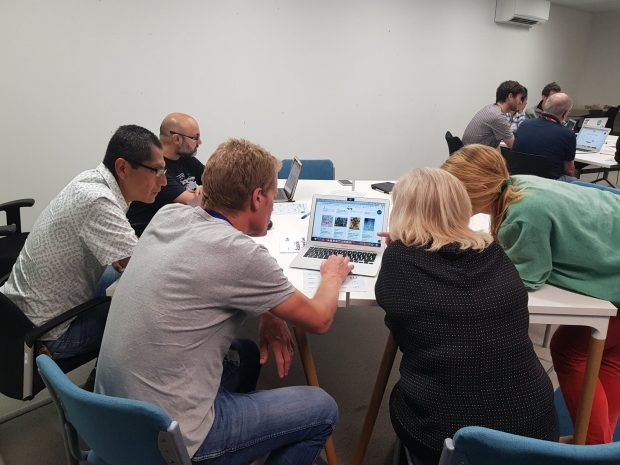 Photo of aphasia advisor Lynn and GDS User researcher doing a usability task together